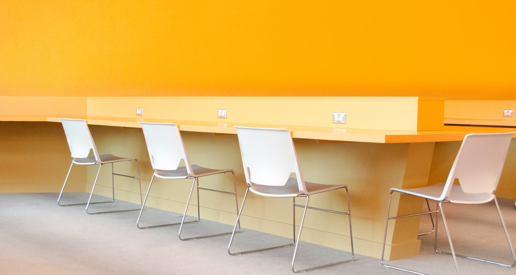 Chairs with a yellow background