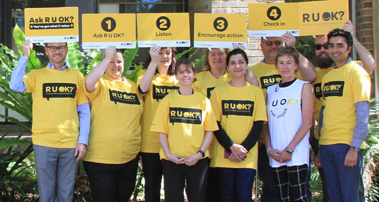 UNSW staff in yellow R U OK Day t-shirts outside the Chancellery