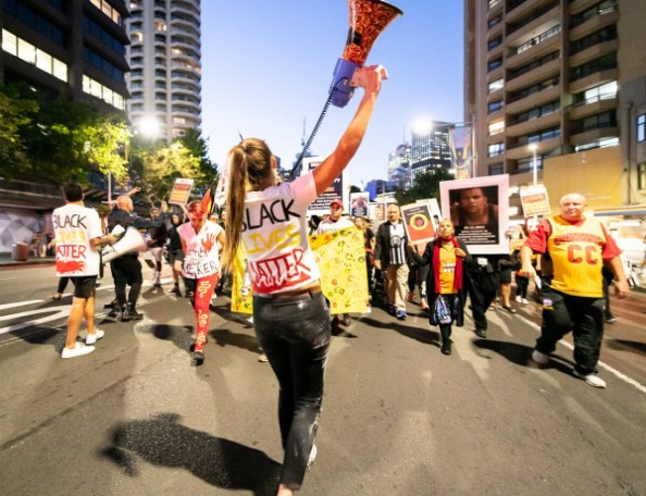 Vanessa Turnbull-Roberts leads a march in Sydney. Image: John Janson-Moore