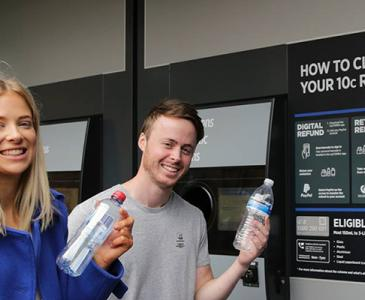Students using the Return and Earn reverse vending machine