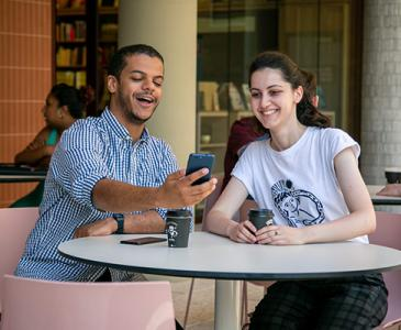 UNSW students enjoying the Uni-verse app at UNSW Bookshop